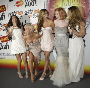 British group Girls Aloud pose backstage at the Brit Awards 2009 at Earls Court exhibition centre in London, England, Wednesday, Feb. 18, 2009 after winning a prize for best British Single of the year. From left, Cheryl Cole, Sarah Harding, Nadine Coyle, Nicola Roberts and Kimberly Walsh. (AP Photo/Joel Ryan)