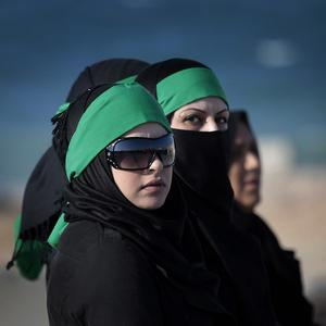 Women gather in Tripoli at a mass funeral for people allegedly killed in coalition bombings on Libya (AP)