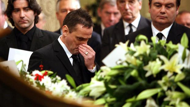 George Best's agent Phil Hughes (centre) with Eamonn Holmes next to George Best's coffin in the Parliament buildings in Stormont, Belfast, Saturday December 3, 2005. The world of football was today paying its last respects as George Best, one of the greatest ever players, was laid to rest. Best, 59, died last Friday in London's Cromwell Hospital.