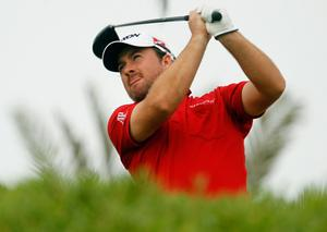 Graeme McDowell on his way to third place in Abu Dhabi yesterday after a round of 66.