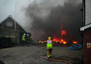 A major fire broke out on Monday evening at Molloy's scrap yard on the Monaghan Road, Armagh, near Madden. At least 10 fire engines and numerous specialist appliances continue to fight the blaze which threaten adjacent dwellings and commercial units. No one was injured as stated by the PSNI.                 Picture: