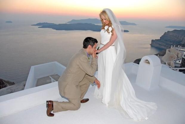 """Krysta Beggs and Stephen McCormick from Belfast married in Oia, Santorini.  <p><b>To send us your Wedding Pics <a  href=""""http://www.belfasttelegraph.co.uk/usersubmission/the-belfast-telegraph-wants-to-hear-from-you-13927437.html"""" title=""""Click here to send your pics to Belfast Telegraph"""">Click here</a> </a></p></b>"""