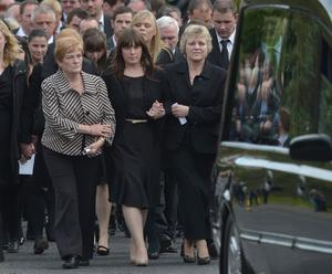 19/9/12 PACEMAKER BELFAST.  Essie Spence is comforted by family members at todays funeral in Ballynahinch of Noel, Nevin and Graham Spence who died following a tragic farming accident at their Hillsborough home at the weekend. Picture Charles McQuillan/Pacemaker.