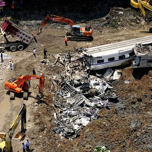 The wreckage of train carriages in Wenzhou, Zhejiang Province, east China (AP)