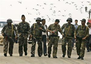 Indian commandos return after the completion of their operation inside the Taj Mahal hotel in Mumbai, India, Saturday, Nov. 29, 2008. Indian commandos killed the last remaining gunmen holed up at a luxury Mumbai hotel Saturday, ending a 60-hour rampage through India's financial capital by suspected Islamic militants that killed people and rocked the nation. (AP Photo/Gurinder Osan)