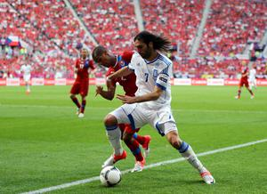 WROCLAW, POLAND - JUNE 12:  Theodor Gebre Selassie of Czech Republic and Giorgos Samaras of Greece fight for the ball during the UEFA EURO 2012 group A match between Greece and Czech Republic at The Municipal Stadium on June 12, 2012 in Wroclaw, Poland.  (Photo by Christof Koepsel/Getty Images)
