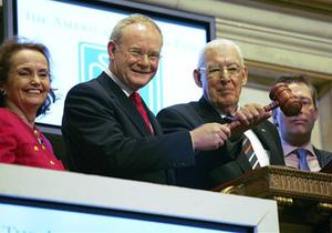 Loretta Brennan Glucksman, left, chairman of The American Ireland Fund, and Junior Minister Ian Paisley Jr., right, join the two leaders of Northern Ireland's newly devolved government, First Minister Dr. Ian Paisley, center right, and Deputy First Minister Martin McGuinness, center left, as they hold the gavel for a photo opportunity at the New York Stock Exchange, Monday, Dec., 3, 2007