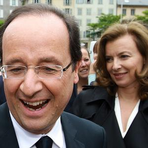 Valerie Trierweiler, see here with her partner French President Francois Hollande, has created a storm on Twitter (AP)