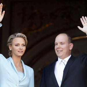 Prince Albert II of Monaco and his bride wave from the balcony at the Monaco palace (AP)