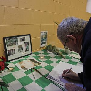 A local signs the book of condolence in Detective Garda Adrian Donohoe's football club St Patrick's GFC in Co Louth, Leinster