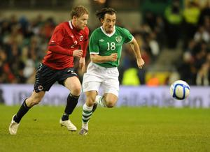 Norway's Tom Hogli in action with Republic of Ireland's Stephen Hunt (right) during the International Friendly at the AVIVA Stadium, Dublin, Ireland. PRESS ASSOCIATION Photo. Picture date: Wednesday November 17, 2010. See PA story SOCCER Republic. Photo credit should read: Barry Cronin/PA Wire.