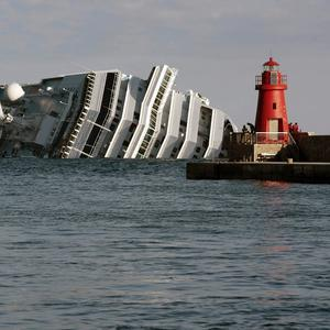The cruise ship Costa Concordia leans on its side after running aground on the tiny Tuscan island of Giglio, Italy (AP)