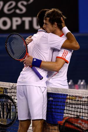 MELBOURNE, AUSTRALIA - JANUARY 27:  Novak Djokovic of Serbia hugs Andy Murray of Great Britain after winning his semifinal match against Andy Murray of Great Britain during day twelve of the 2012 Australian Open at Melbourne Park on January 27, 2012 in Melbourne, Australia.  (Photo by Clive Brunskill/Getty Images)