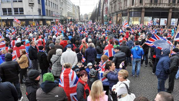 Protesters converge on Belfast City Hall on Saturday afternoon following the removal of the Union flag earlier this week