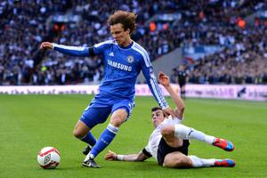 LONDON, ENGLAND - APRIL 15:  David Luiz of Chelsea is tackled by Gareth Bale of Tottenham Hotspur during the FA Cup with Budweiser Semi Final match between Tottenham Hotspur and Chelsea at Wembley Stadium on April 15, 2012 in London, England.  (Photo by Mike Hewitt/Getty Images)