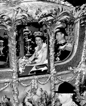 File photo dated 02/06/1953 of Queen Elizabeth II accompanied by the Duke of Edinburgh, in the Royal Coach as it neared Trafalgar Square, London on the route to Westminster. PRESS ASSOCIATION Photo.