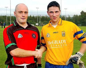 PSNI GAA Captain Peadar Heffron (left), who was injured in the booby trap attack, and St Brigid's captain Stephen Morrisey before the first competitive GAA match involving the police force