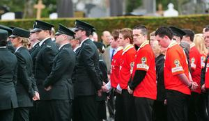 A joint guard of honor from Ronan's GAA team and his PSNI colleagues at the funeral Mass of Constable Ronan Kerr