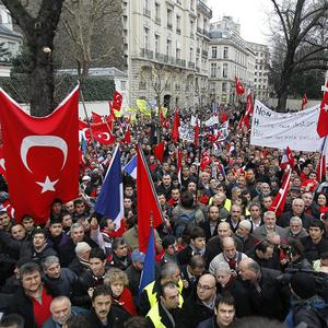 Demonstrators from France's Turkish community protest outside the parliament in Paris (AP)