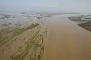 Floods spread for hundreds of kilometres, as seen from a Pakistan Army helicopter on an aid mission