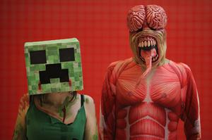 LONDON, ENGLAND - OCTOBER 26: Kimmy Parris 21, from Dartford (L) poses as a Creeper from Minecraft with friend Chris Hayne 26, from Sheffield as a Licker from Resident Evil ahead of the MCM London Comic Con Expo at ExCel on October 26, 2012 in London, England. Visitors to the Comic Convention are encouraged to wear a costume of their favourite comic character and flock to the Expo to gather all the latest news in the world of comics, manga, anime, film, cosplay, games and cult fiction.  (Photo by Dan Kitwood/Getty Images)