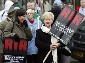 Irish Republican protesters opposed to the British Army make their point as the British Army's Royal Irish Regiment parades through Belfast City under tight security from riot police, in Belfast, Northern Ireland, Sunday, Nov. 2, 2008.  Riot police kept apart rival loyalist and Republican supporters at a parade to honor Northern Ireland members of British armed forces that have recently returned from war zones in Iraq and Afghanistan. (AP Photo/Peter Morrison)