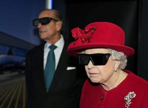 18/11/10  Queen Elizabeth II and the Duke of Edinburgh wearing 3D glasses to watch a display and pilot a JCB digger during a visit to the University of Sheffield Advanced Manufacturing Research centre. PRESS ASSOCIATION Photo.