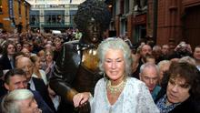 .A statue of Thin Lizzy front man Phil Lynott is unveiled by his mother Philomena (centre), Friday August 19, 2005, on the corner of Grafton Street and Harry Street in Dublin