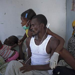 Patients with cholera receive medical attention at St Nicholas hospital in Saint Marc, Haiti