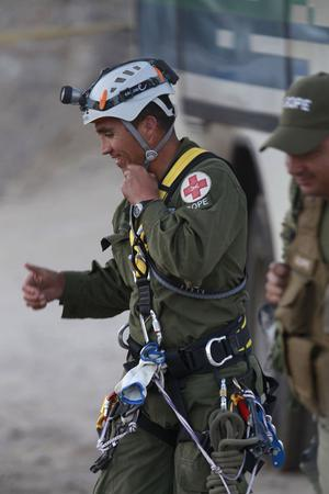 Patricio Sepulveda, a corporal of the police special operations unit, smiles after arriving at the San Jose mine near Copiapo, Chile