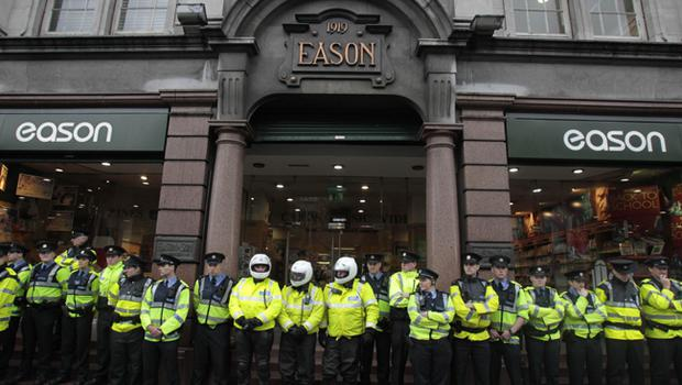 Gardai line the shop front of Eason's bookstore as former Prime Minister Tony Blair attends his first book signing in Dublin