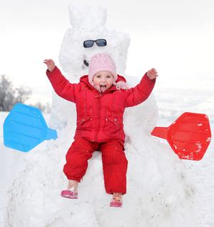 Becca Lilly (3) from Newtownabbey, pictured sitting on a huge snowman, enjoying the February snow