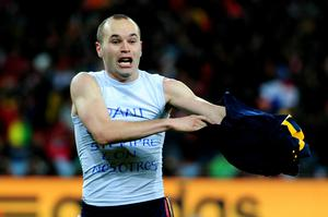 Andres Iniesta of Spain celebrates scoring the winning goal during the 2010 FIFA World Cup South Africa Final match between Netherlands and Spain at Soccer City Stadium on July 11, 2010 in Johannesburg, South Africa