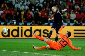 Andres Iniesta of Spain scores the winning goal during the 2010 FIFA World Cup South Africa Final match between Netherlands and Spain at Soccer City Stadium on July 11, 2010 in Johannesburg, South Africa