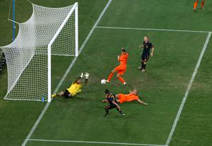 David Villa of Spain misses a goal scoring chance as goalkeeper Maarten Stekelenburg of the Netherlands dives and John Heitinga and Gregory Van Der Wiel attempt to block during the 2010 FIFA World Cup South Africa Final match between Netherlands and Spain at Soccer City Stadium on July 11, 2010 in Johannesburg, South Africa