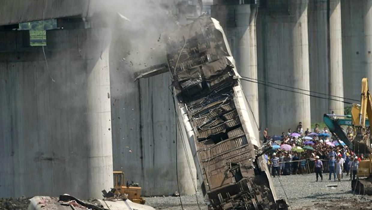 Workers clear up the wreckage after a train accident in Wenzhou in east China's Zhejiang province (AP)