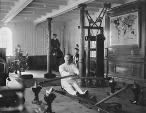 Shipyard worker William Parr (background) pictured in the Titanic gym along with instructor T W McCawley