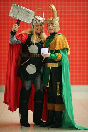 LONDON, ENGLAND - OCTOBER 26:  Emma O'Neil, 20, from Belfast (L) poses as Thor with Autumn McCullough, 20, from Belfast (R) as Loki from the series Thor ahead of the MCM London Comic Con Expo at ExCel on October 26, 2012 in London, England. Visitors to the Comic Convention are encouraged to wear a costume of their favourite comic character and flock to the Expo to gather all the latest news in the world of comics, manga, anime, film, cosplay, games and cult fiction.  (Photo by Dan Kitwood/Getty Images)