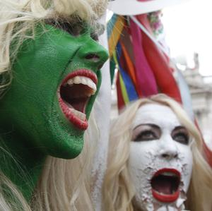 Demonstrators in Rome, painted in colours of the Italian flag, shout slogans against Sivlio Berlusconi (AP)