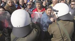 Demo: anti-austerity protesters face police at a student march in Greece, where debt has caused turmoil on the world markets