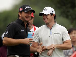 Rory McIlroy with Graeme McDowell during the final round of the WGC-HSBC Champions in Shanghai yesterday