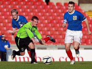 LInfield captain Michael Gault (right) is staying focused even though the league title race is over