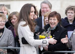 BELFAST, NORTHERN IRELAND - MARCH 08:  Kate Middleton meets members of the public as she arrives at City Hall on March 8, 2011 in Belfast, Northern Ireland. The Royal Couple are visiting Northern Ireland as part of a tour of the country that a couple of weeks ago took them to St Andrews University in Scotland and Anglesey in North Wales to launch a lifeboat. This day-long trip to Ireland has been kept top secret due to security issues. They will marry on the 29th April at Westminster Abbey in a much anticipated ceremony.  (Photo by Chris Jackson/Getty Images)