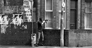 The Last Gunman by Brendan Murphy, July 1997. An IRA man on the Lower Ormeau area fires at a police roadblock on the bridge across the River Lagan. Within weeks, the IRA declared its second ceasefire.