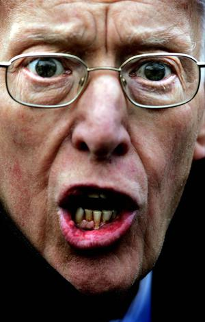 Former DUP leader Ian Paisley reacts to questioning from the media outside Castle Buildings