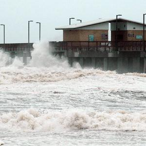 Waves crash into the pier at Gulf State Park in Gulf Shores, Alabama (AP/Jay Reeves)