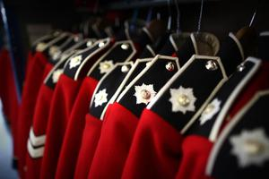 WINDSOR, ENGLAND - APRIL 21:  Irish Guards ceremonial uniforms await collection in a stor room at Victoria Barracks on April 21, 2011 in Windsor, England. The Irish Guards returned from active duty in Afghanistan at the beginning of April, and are now preparing for ceremonial duties. Prince William is the Colonel of the Regiment and the Irish Guards will be on duty at the Royal Wedding on April 29, 2011.  (Photo by Peter Macdiarmid/Getty Images)