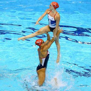 Athletes from the Great Britain Women's Synchronised Swimming team practice during a training session ahead of the London Olympic Games at the Aquatics Centre in Olympic Park on July 25, 2012 in London, England.  (Photo by Al Bello/Getty Images)