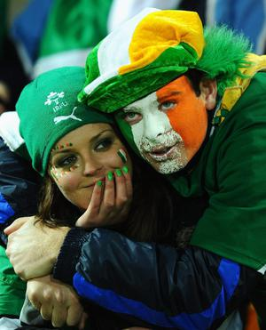 Ireland fans show their dejection after quarter final one of the 2011 IRB Rugby World Cup between Ireland v Wales