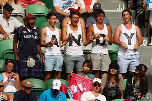 MELBOURNE, AUSTRALIA - JANUARY 25:  Spectators show their support in the quarterfinal match between Andy Murray of Great Britain Kei Nishikori of Japan during day ten of the 2012 Australian Open at Melbourne Park on January 25, 2012 in Melbourne, Australia.  (Photo by Cameron Spencer/Getty Images)